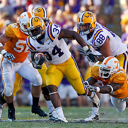 Oct 2, 2010; Baton Rouge, LA, USA; LSU Tigers running back Stevan Ridley (34) runs away from Tennessee Volunteers defensive end Chris Walker (84) during the second half at Tiger Stadium. LSU defeated Tennessee 16-14.  Mandatory Credit: Derick E. Hingle