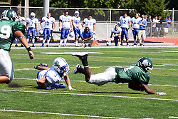 17 September 2011: Cameron Allen is stopped courtesy of Bo Price during an NCAA Division 3 football game between the Aurora Spartans and the Illinois Wesleyan Titans on Wilder Field inside Tucci Stadium in.Bloomington Illinois.