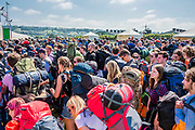 Queueing outside the wall after arriving by bus - The 2019 Glastonbury Festival, Worthy Farm. Glastonbury, 26 June 2019
