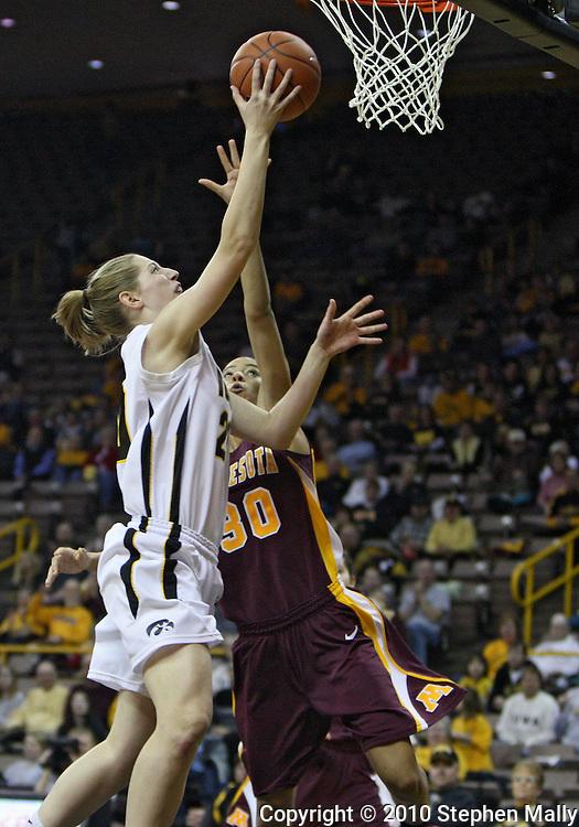 February 18, 2010: Iowa forward Kelly Krei (20) puts up a shot past Minnesota guard Kiara Buford (30) during the first half of the NCAA women's basketball game at Carver-Hawkeye Arena in Iowa City, Iowa on February 18, 2010. Iowa defeated Minnesota 75-54.