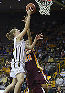 February 18, 2010: Iowa forward Kelly Krei (20) puts up a shot past Minnesota guard Kiara Buford (30) during the first half of the NCAA women's basketball game at Carver-Hawkeye Arena in Iowa City, Iowa on February 18, 2010. Iowa defeated Minnesota 75-54.