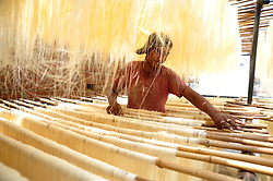 May 28, 2017 - Allahabad, Uttar Pradesh, India - Allahabad: A worker drying vermicelli at a factory during Ramadan month in Allahabad on 28-05-2017, Vermicelli is most populer sweet dish used by Muslims during Ramadan month. Photo by prabhat kumar verma (Credit Image: © Prabhat Kumar Verma via ZUMA Wire)