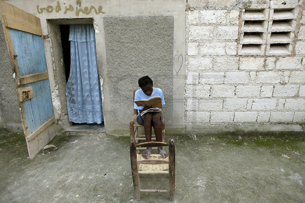 2009/11/16 20:20:16 / haiti 2009 / _MG_2371<br /> PHOTO PETER PEREIRA<br /> <br />  Fabiola Pierre Louis 16 studies in front of her room at her parents home high in the mountainside above Carrefour, Haiti.  With no public school system, youngsters like Fabiola, are forced to ask for sponsorship from foreigners who for $25/week pay for their schooling.