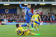 Jake Reeves midfielder for AFC Wimbledon (8) skips Seamus Conneely midfielder Accrington Stanley (28) challenge during  the Sky Bet League 2 Play-Off first leg match between AFC Wimbledon and Accrington Stanley at the Cherry Red Records Stadium, Kingston, England on 14 May 2016. Photo by Stuart Butcher.