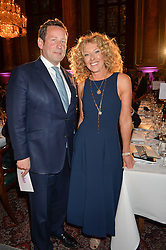 ED VAIZEY and  KELLY HOPPEN at the LDNY Fashion Show and WIE Award Gala sponsored by Maserati held at The Goldsmith's Hall, Foster Lane, City of London on 27th April 2015.