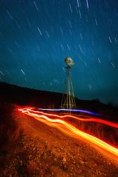 Windmill and night sky, Dolan Falls Preserve, Devils River, Texas