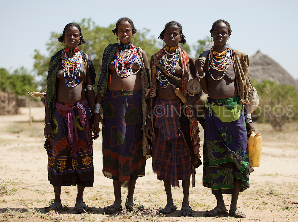 This is a very exotic and a small tribe living in the Weyto Valley Desert living in a very harsh physical enviroment. The Arbore women generally wear a large black cloth to cover their heads. They perform many ritual-like dances while singing. They believe that dancing and singing with eliminate negative energies and give positive energy that will bring good-luck. The Arbore measure their wealth by the number of cattle they own..