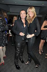 JULIEN MACDONALD and MELISSA ODABASH at a dinner hosted by Ruinart Champagne for Yasmin Mills at Nobu, Park Lane, London on rth May 2009.