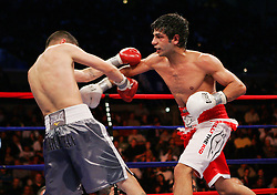 October 18, 2008; Atlantic City, NJ, USA;  Steven Luevano (gray trunks) and Billy Dib (white/red trunks) trade punches during their 12 round WBO World Featherweight Championship fight at Boardwalk Hall in Atlantic City, NJ.  won the fight via