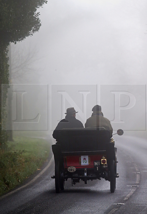 © Licensed to London News Pictures. 01/11/2015. Staplefield, UK. A 1901 De Dion Bouton heads for Staplefield on a foggy road as it takes part in the London to Brighton Veteran Car Run.  Photo credit: Peter Macdiarmid/LNP