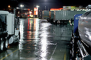 parked freight trucks at night