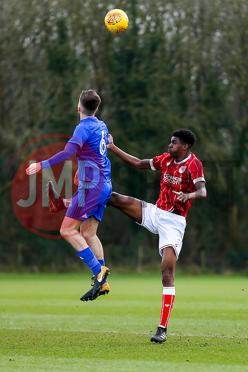 Paul Mckay of Cardiff City U23 is challenged by Tyreeq Bakinson of Bristol City U23 - Rogan/JMP - 19/02/2018 - Failand Training Ground - Bristol, England - Bristol City U23 v Cardiff City U23.