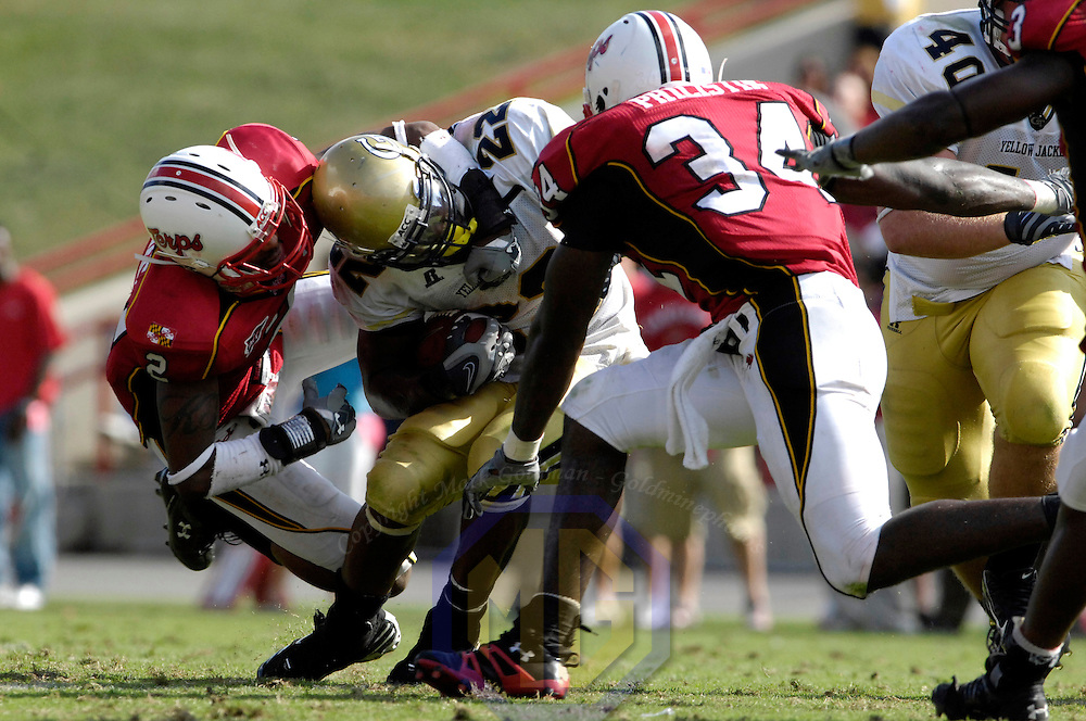 06 October 2007:  Georgia Tech running back Tashard Choice (22) is tackled by Maryland defensive back Kevin Barnes (2) for no gain in the 4th quarter on October 6, 2007 at Byrd Stadium in College Park, Maryland.  The Maryland Terrapins defeated the Georgia Tech Yellow Jackets 28-26.