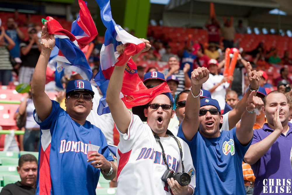 7 March 2009: Dominican fans enjoy the game during the 2009 World Baseball Classic Pool D match at Hiram Bithorn Stadium in San Juan, Puerto Rico. Netherlands pulled off a huge upset in their World Baseball Classic opener with a 3-2 victory over Dominican Republic.