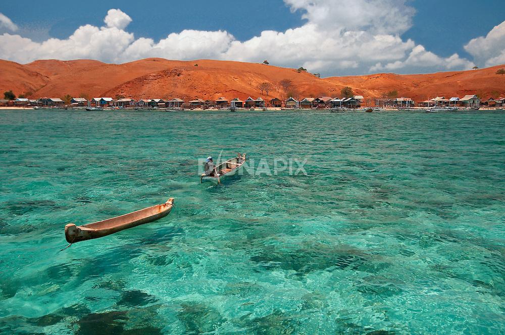 Clear aqua waters, dug out canoe, red island, PapagaranKomodo National Park