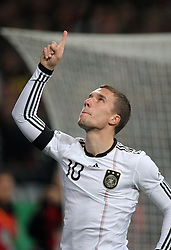 LUKAS PODOLSKI POINTS TO HEAVEN AFTER SCORING PENALTY.GERMANY V IVORY COAST.GERMANY V IVORY COAST.VELTINS ARENA, GELSENKIRCHEN, GERMANY.18 November 2009.GAA3880..  .WARNING! This Photograph May Only Be Used For Newspaper And/Or Magazine Editorial Purposes..May Not Be Used For, Internet/Online Usage Nor For Publications Involving 1 player, 1 Club Or 1 Competition,.Without Written Authorisation From Football DataCo Ltd..For Any Queries, Please Contact Football DataCo Ltd on +44 (0) 207 864 9121