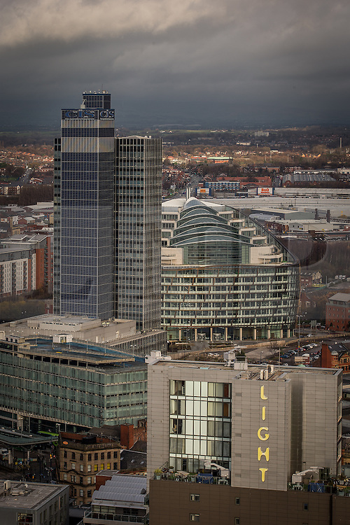 © Licensed to London News Pictures . 07/12/2013 . The old Co-operative tower - CIS Tower - left and behind , Noma at 1 Angel Square , home to the new Co-operative offices . Co-operative old and new , Light , coop . Cityscape view of Manchester . Photo credit : Joel Goodman/LNP