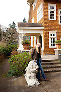 The Portland, Oregon home of Wendy Burden, author of  the memoir, Dead End Gene Pool.  Ms. Burden in her front yard with the lions from Florham, her great-grandmother's childhood home. (The home and lions are on the front cover of her book)