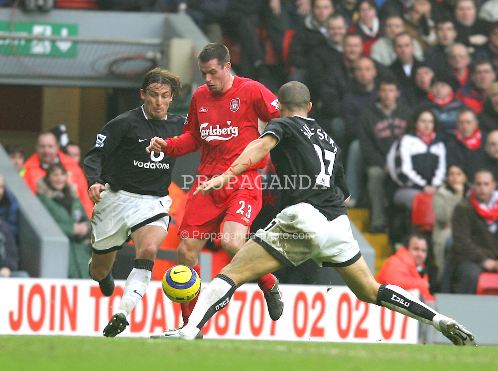 LIVERPOOL, ENGLAND - SATURDAY JANUARY 15th 2005: Liverpool's Jamie Carragher gets in between Manchester United's Gabriel Henize (L) and Mikael Silvestre (R) during the Premiership match at Anfield. (Pic by David Rawcliffe/Propaganda)