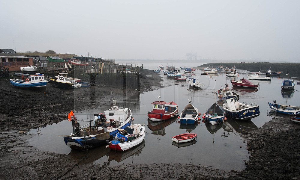 &copy; Licensed to London News Pictures. <br /> 17/03/2015. <br /> <br /> South Gare, Teesside.<br /> <br /> Fishing boats are moored up at low tide at an area known as Paddy's Hole at South Gare on the mouth of the River Tees.<br /> <br /> Photo credit : Ian Forsyth/LNP