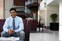 Businessman sitting on sofa portrait
