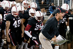 September 18, 2010; Stanford, CA, USA; Stanford Cardinal head coach Jim Harbaugh leads his team onto the field before the game against the Wake Forest Demon Deacons at Stanford Stadium. Stanford defeated Wake Forest 68-24.