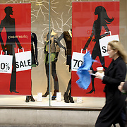 Sale posters in shop windows on british High Street