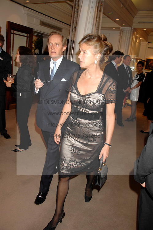 The MARQUESS & MARCHIONESS OF DOURO at the Sotheby's Summer Party 2007 at their showrooms in New Bond Street, London on 4th June 2007.<br />