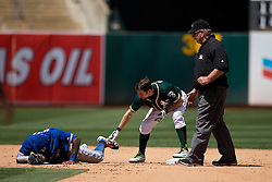OAKLAND, CA - JULY 23:  Jose Reyes #7 of the Toronto Blue Jays is injured on a play at second base next to Billy Burns #1 of the Oakland Athletics during the eighth inning at O.co Coliseum on July 23, 2015 in Oakland, California. The Toronto Blue Jays defeated the Oakland Athletics 5-2. (Photo by Jason O. Watson/Getty Images) *** Local Caption *** Jose Reyes; Billy Burns