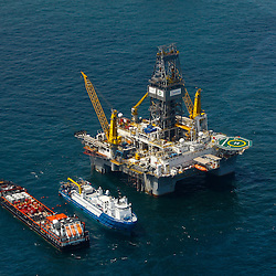 The Transocean Development Driller III rig is nearing completion of the first relief well at the BP Plc MC252 well site in the Gulf of Mexico off the coast of Louisiana, U.S., on Sunday, July 18, 2010. BP Plc said that a pressure test on its damaged Macondo well halted the flow of oil into the Gulf for the first time in three months. The oil spill, the biggest in U.S. history, had been spewing 35,000 to 60,000 barrels of oil a day since the drilling rig exploded on April 20. Photographer: Derick E. Hingle/Bloomberg