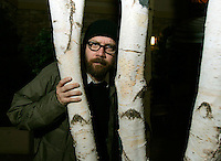 "Cast member Paul Giamatti poses in a stand of trees at the 25th annual Sundance film festival in Park City, Utah January 23, 2006. Giamatti appears in ""The Illusionist"" showing at Sundance. The film takes place in turn-of-the-century Vienna, where a magician uses his abilities to secure the love of a woman far above his social standing. REUTERS/Rick Wilking"