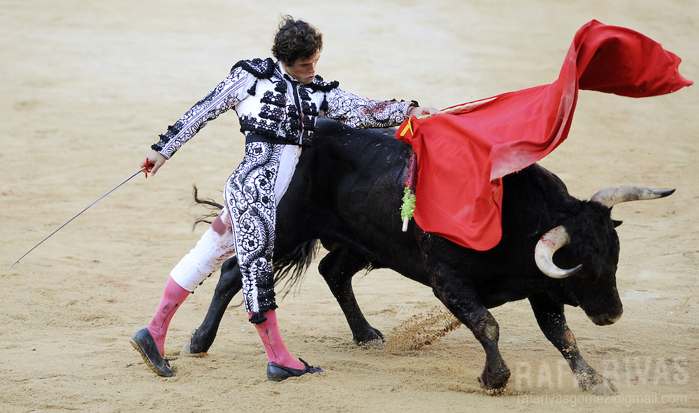 Spanish matador Miguel Abellan gives a pass with muleta to his Conde de la Corte fighting bull during the first corrida of the San Fermin festivities, on July 7, 2008, in Pamplona, northern Spain.