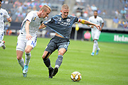 Jackson Yueill of the San Jan Jose Earthquakes tries to get the ball away from Alexander Ring of NYCFC during a MLS soccer game, Saturday, Sept. 14, 2019, in New York.NYCFC defeated San Jose Earthquakes 2-1.(Errol Anderson/Image of Sport)