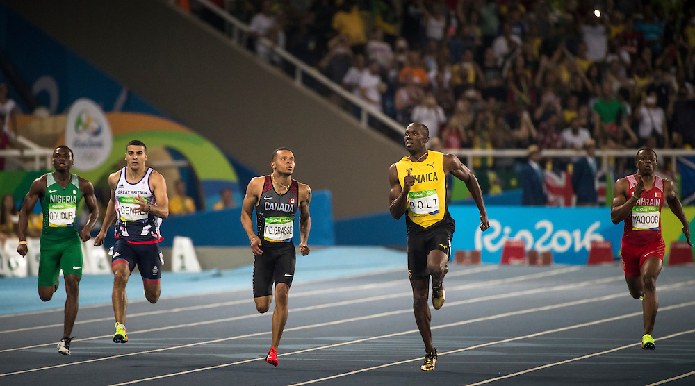 Andre DeGrasse and Usain Bolt run the Olympic 200m semi final in Rio de Janeiro on August 17, 2016.