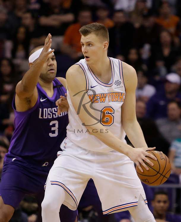 New York Knicks forward Kristaps Porzingis (6) in the first half during an NBA basketball game against the Phoenix Suns, Friday, Jan. 26, 2018, in Phoenix. (AP Photo/Rick Scuteri)