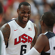 Lebron James, USA, celebrates victory with team mate Chris Paul during the Men's Basketball Final between USA and Spain at the North Greenwich Arena during the London 2012 Olympic games. London, UK. 12th August 2012. Photo Tim Clayton