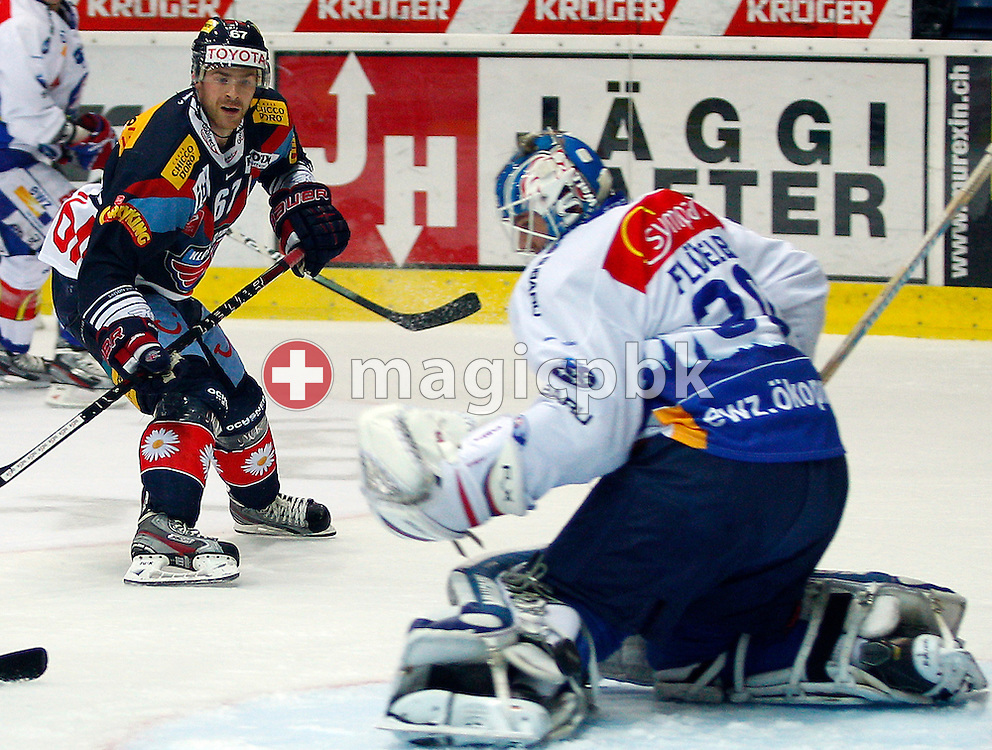 Kloten Flyers forward Romano Lemm (L) against ZSC Lions goaltender Lukas Flueeler during the ice hockey game of the Swiss National League A (Season 2011-2012) between Kloten Flyers and ZSC Lions held at the Kolping Arena in Kloten, Switzerland, Tuesday, Oct. 25, 2011. (Photo by Patrick B. Kraemer / MAGICPBK)