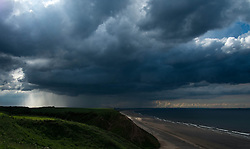 © Licensed to London News Pictures. <br /> 10/06/2014. <br /> <br /> Saltburn, United Kingdom.<br /> <br /> Dark thunder clouds form over Teesside.<br /> <br /> Photo credit : Ian Forsyth/LNP