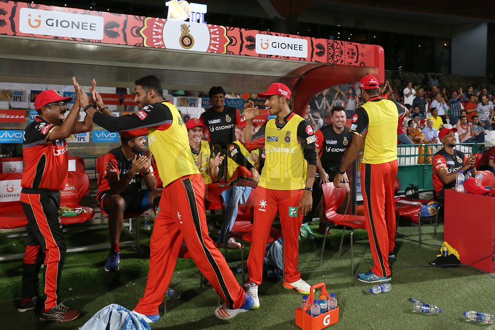 Royal Challengers Bangalore players in dugout celebrating after winning the match 5 of the Vivo 2017 Indian Premier League between the Royal Challengers Bangalore and the Delhi Daredevils held at the M.Chinnaswamy Stadium in Bangalore, India on the 8th April 2017<br /> <br /> Photo by Faheem Hussain - IPL - Sportzpics