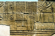Imhotep (active c2980 BC) Ancient Egyptian physician (right, seated) surgical instruments (centre) birthing chair (left). Limestone relief .