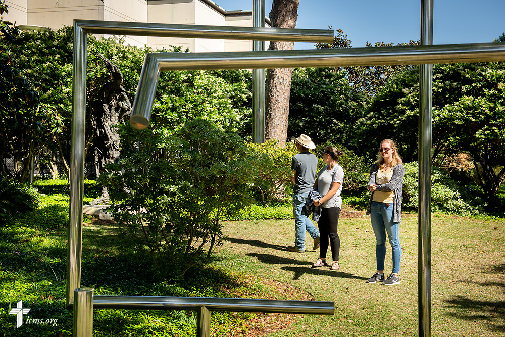 Young Adult Corps participants (left to right) Hayden Duncan, Madison Ezzell, and Courtney Haag browse the Sydney and Walda Besthoff Sculpture Garden at the New Orleans Museum of Art during some free time before evening worship on Wednesday, April 4, 2018, in New Orleans. LCMS Communications/Erik M. Lunsford