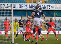 Football - 2019 / 2020 EFL Championship -  Millwall vs. Huddersfield Town<br /> <br /> Matt Smith (Millwall FC) proves an aerial handful as he rises to meet another high ball into the box at The Den.<br /> <br /> COLORSPORT/DANIEL BEARHAM