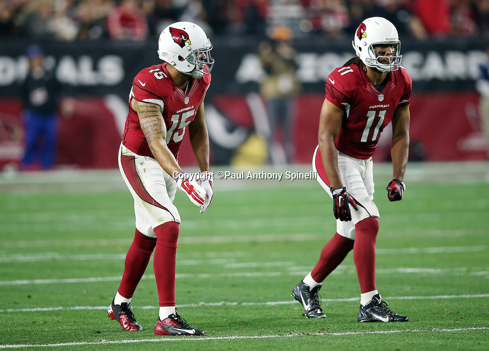 Arizona Cardinals wide receiver Michael Floyd (15) and Arizona Cardinals wide receiver Larry Fitzgerald (11) get set to go out for a pass during the NFL NFC Divisional round playoff football game against the Green Bay Packers on Saturday, Jan. 16, 2016 in Glendale, Ariz. The Cardinals won the game in overtime 26-20. (©Paul Anthony Spinelli)