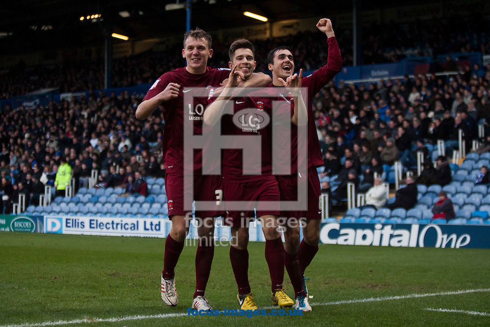 Picture by Daniel Chesterton/Focus Images Ltd +44 7966 018899.26/01/2013.James Poole of Hartlepool United (centre) celebrates scoring his side's second goal during the npower League 1 match at Fratton Park, Portsmouth.