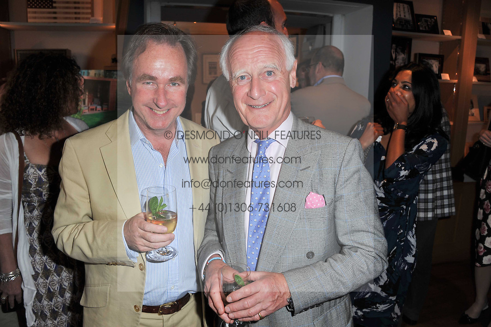 Left to right, ANDREW CHANCE and NIGEL MASSEY at a party to celebrate the publication of 'Garden' by Randle Siddeley held at Linley, 60 Pimlico Road, London on 24th May 2011.