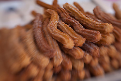 North America, Mexico, Guanajuato State, San Miguel de Allende, stack of traditional fried churros for sale in market