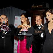 NLD/Amsterdam/20100929 - Pink Ribbon Gala 2010, Angela Groothuizen, Quinty Trustfull, Henk van der Mark en Pia Douwes geven het startsein voor de roze verlichting van de Westerkerk in Amsterdam