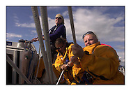 The Clipper Around the World Race 2000..During three weeks training in sailing offshore, motivated novices from all walks of life prepare to circumnavigate the globe..Susan Gibb, Kathryn Smith & Karen Sheridan work the main aboard Glasgow...Marc Turner / PFM.www.pfmpictures.co.uk