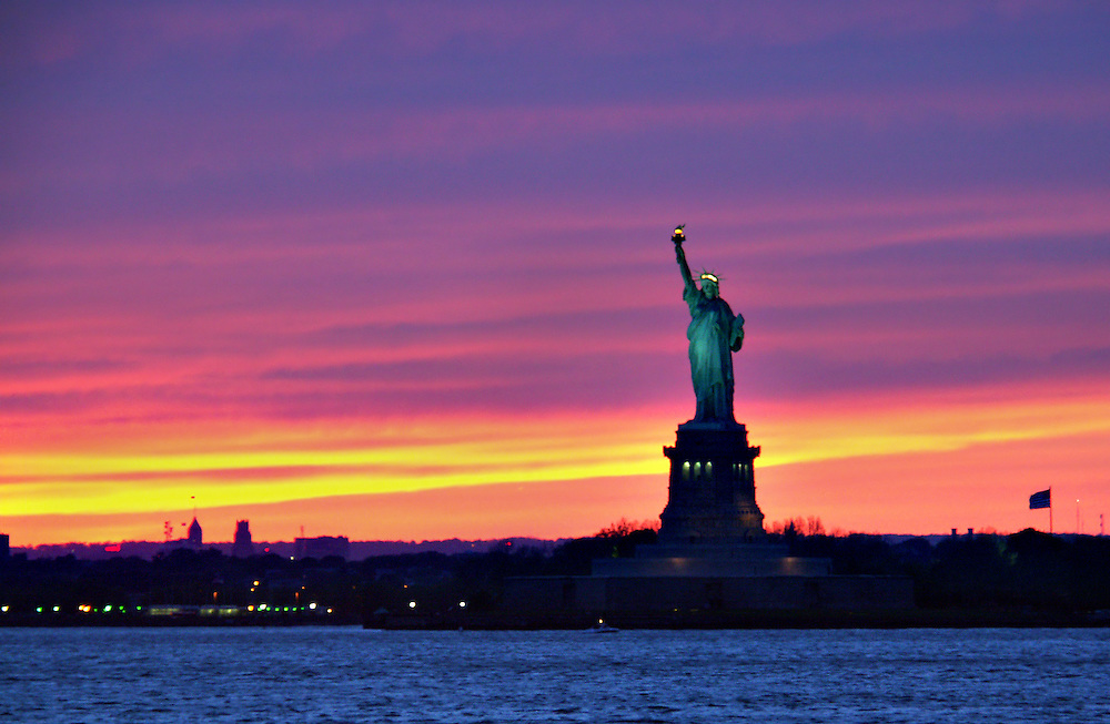 Rainbow like sunset behind Lady Liberty. 2004