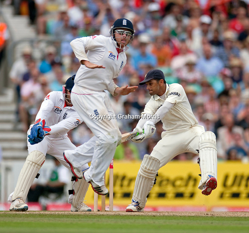 Rahul Dravid bats (past a leaping Ian Bell) during the fourth and final npower Test Match between England and India at the Oval, London.  Photo: Graham Morris (Tel: +44(0)20 8969 4192 Email: sales@cricketpix.com) 21/08/11
